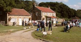 Spectators enjoy the annual Individual Quoits Championship at Beckhole